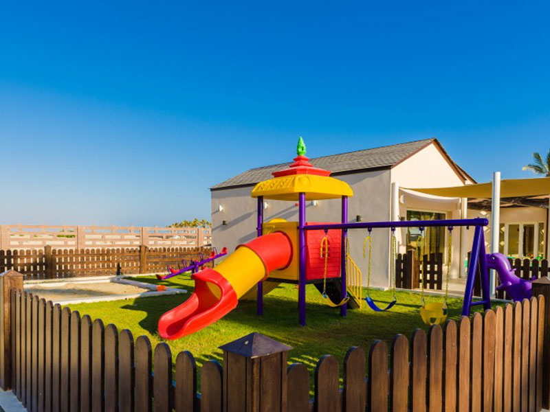 kids play area with slider and swing inside fanar hotel and residences in salalah oman