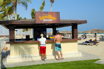 morning view of sandbar beach bar with guests ordering some drinks inside fanar hotel in hawana salalah