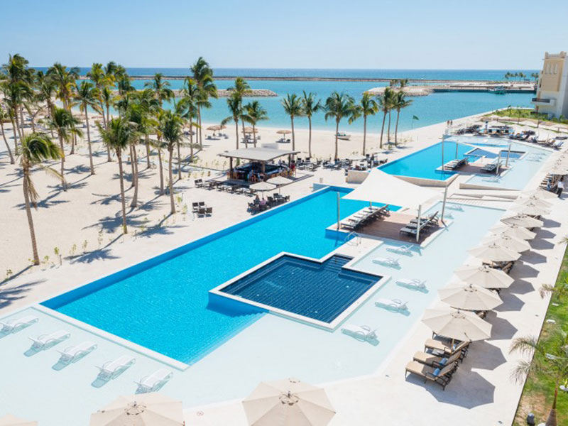 pools seating area with sea view from fanar hotel and residences in hawana salalah