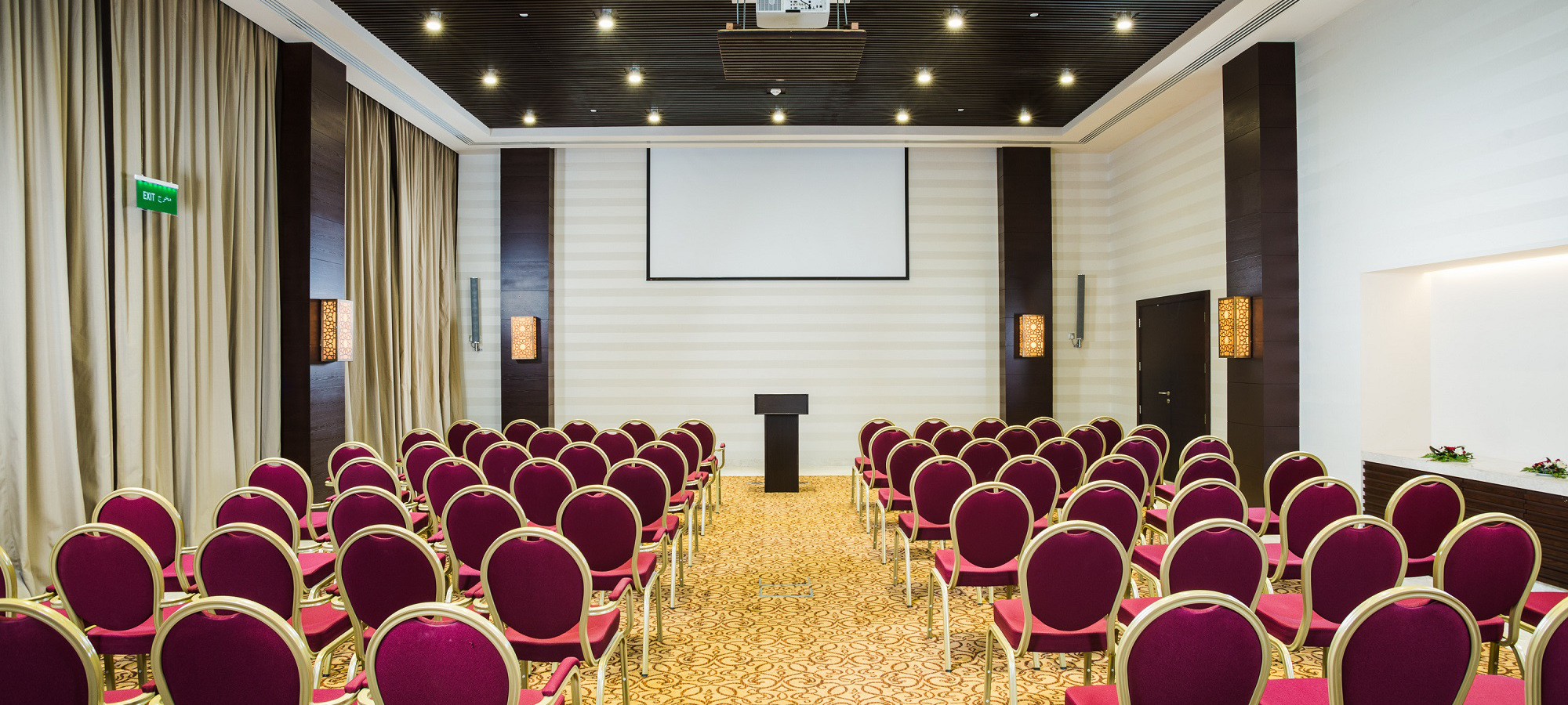 conference room with projector in fanar hotel at hawana salalah