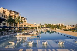 Fanar Hotel swimming pool with luxury service and surrounded by laid back sunbeds in Salalah Oman
