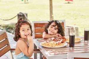 2 kids having their delicious lunch at Fanar Hotel and Residences restaurant, the family resort in Hawana Salalah Oman