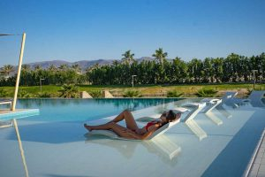 A girl is chilling out and enjoying her time by Fanar Hotel Swimming Pool in Salalah Oman