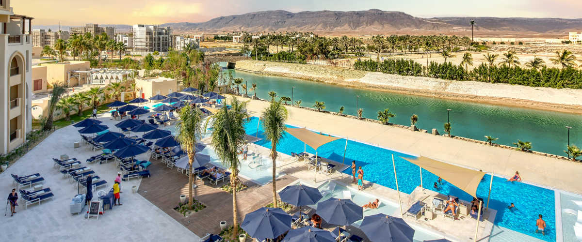 overview of lagoon waters and pools area from fanar hotel in hawana salalah oman