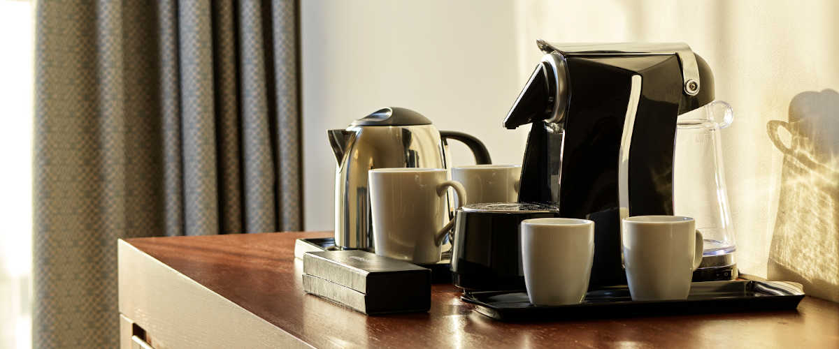 Tea & Coffee facilities served at Fanar luxury accommodation in Salalah Hawana Oman, including coffee maker, cups and kettle