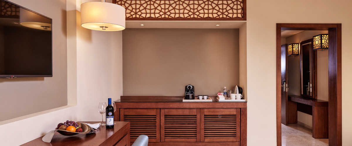 Overview of connected rooms in the deluxe suite at Fanar Resort showing coffee and tea amenities in Oman Luxury Hotel