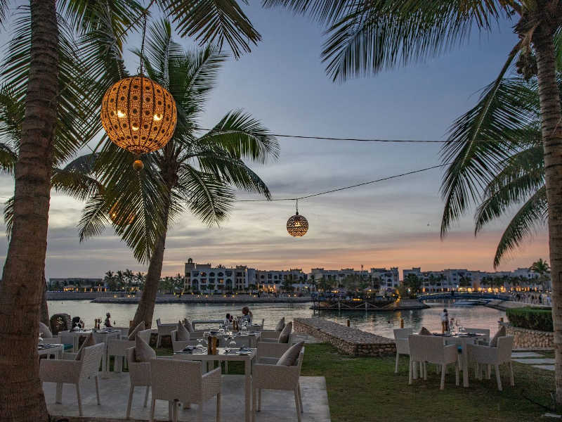 Dining at Aubergine Restaurant outdoor area by the ocean with enjoying the fresh air in Fanar Hotel & Residences the best hotel in Hawana Salalah Oman