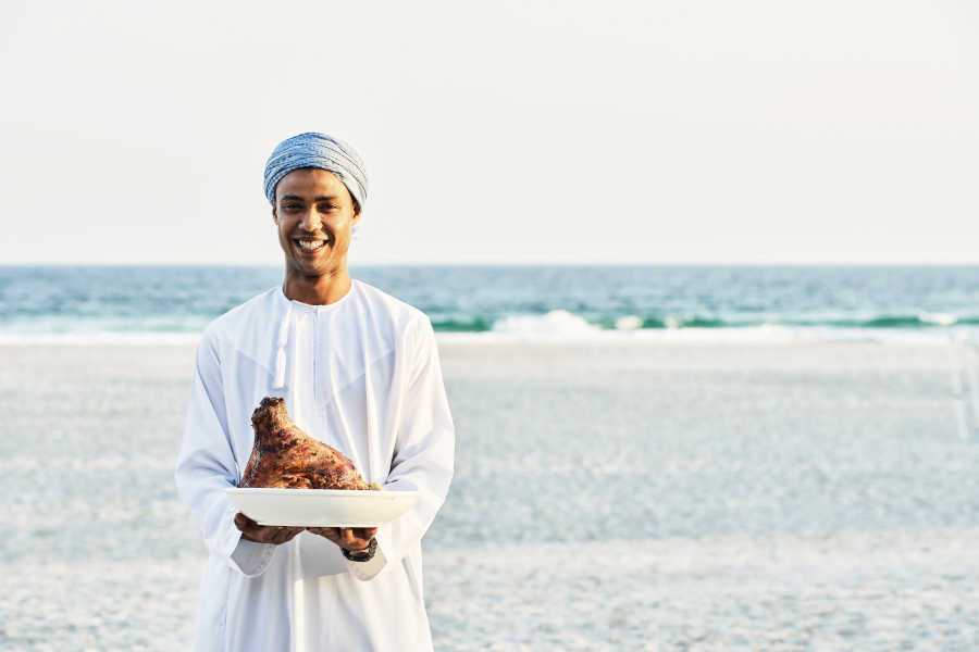 A waiter is serving dining in breakers restaurant in Fanar Hotel & Residences in Hawana Salalah Oman