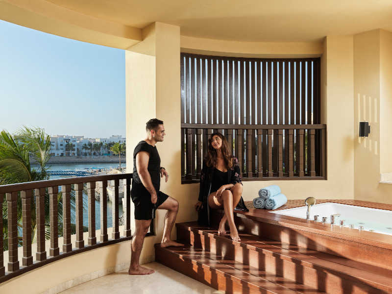A couple enjoying their time at The terrace of Fanar Luxury Suites in Hawana Salalah Oman